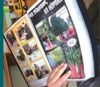 A close-up of a te reo Māori book with photos of people outdoors